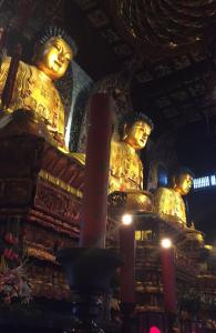 drie gouden boeddhas